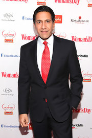 Dr. Sanjay Gupta showed a pop of color with a red tie with dotted squares at the 10th Annual Red Dress Awards.