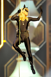 Kelly Ripa made a dramatic stage entrance at the TV Land Awards in this black latex cat suit.