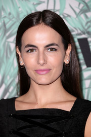 Camilla Belle opted for a casual straight style when she attended the Women in Film pre-Oscar cocktail party.
