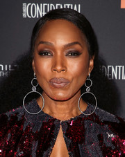 Angela Bassett styled her natural curls into a half-up 'do for the 2018 Hamilton Behind the Camera Awards.