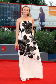 Diane Kruger was a vision at the Venice Film Fest premiere of '11 Minutes' in a white Oscar de la Renta strapless gown embroidered with large black lace flowers.