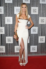 Jennifer Hawkins brought out the vixen-glam look when she donned a fitted white gown with a peek-a-boo gold bustier.