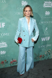 Olivia Wilde was '70s-cool in a pastel-blue bell-bottom suit by Bella Freud at the Women in Film pre-Oscar party.