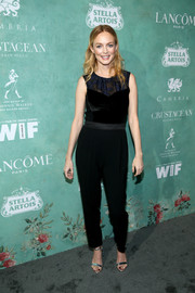 Heather Graham wore a black lace-yoke jumpsuit to the Women in Film pre-Oscar party.