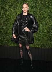 Chloe Sevigny added extra drama with a pair of black lace tights, also by Chanel.