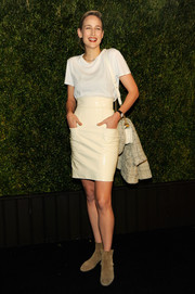 Leelee Sobieski kept it fuss-free in a cream-colored patent mini and a white T-shirt at the Chanel Tribeca Film Festival Artists Dinner.