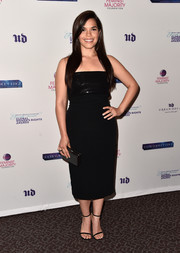 America Ferrera complemented her dress with a studded black clutch.