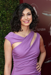 Morena Baccarin attended the John Varvatos Stuart House Benefit wearing bouncy, high-volume curls.