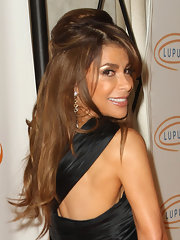 Paula Abdul paired her half up half down hairstyle with Pan Di Zucchero earrings at the Lupus LA Orange Ball.