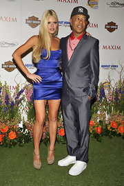 Sophie posed with the hip hop mogul in a blue satin mini dress and a center-parted, straight blonde hairstyle.