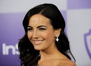 Camilla completed her alluring look with dangling diamond earrings.