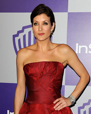 Kate Walsh paired her strapless dress with a french twist bun.