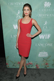 Taylor Hill flaunted her supermodel figure in a fitted red dress by Alexander Wang at the Women in Film pre-Oscar party.