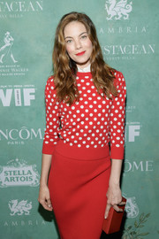 Michelle Monaghan went monochromatic with this red Edie Parker box clutch and Michael Kors sweater and skirt combo at the Women in Film pre-Oscar party.