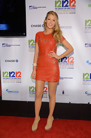 For the second time, Blake wore an orange leather dress on the red carpet. For this occasion, it was a studded mini.