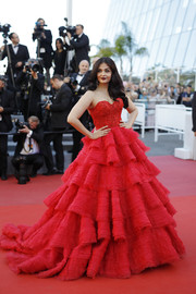 Aishwarya Rai channeled Scarlett O'Hara with this gorgeous red Ralph & Russo Couture gown with a sweetheart neckline and a tiered skirt at the Cannes Film Festival screening of '120 Beats Per Minute.'