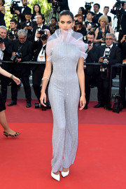 Sara Sampaio sparkled on the red carpet in a beaded and ruffled jumpsuit by Armani Prive at the Cannes Film Festival screening of '120 Beats Per Minute.'