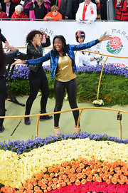 Coco Jones wore a glitzy gold tank top beneath her jacket as she strutted her stuff at the Rose Parade.