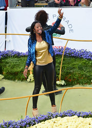 Coco Jones made a bold fashion choice with this electric blue sequined bomber jacket as she participated in the Rose Parade.
