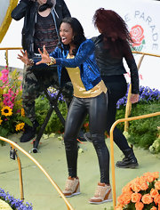 Coco Jones performed at the Tournament of Roses Parade in a pair of studded wedge sneakers.