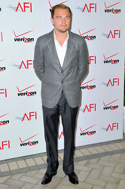 Leonardo DiCaprio paired gray slacks with a patterned jacket for a dapper finish during the AFI Awards.