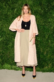 Jessica Hart layered a textured pink robe over a fitted top and a midi skirt for her CFDA/Vogue Fashion Fund Awards look.