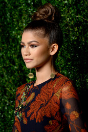 Zendaya Coleman worked a voluminous top knot at the CFDA/Vogue Fashion Fund Awards.