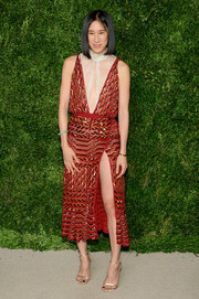 Eva Chen flashed plenty of leg in a high-slit red sequin dress by Altuzarra at the CFDA/Vogue Fashion Fund Awards.