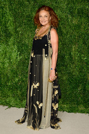 Diane von Furstenberg looked exotic in a butterfly-embroidered sheer-overlay gown at the CFDA/Vogue Fashion Fund Awards.