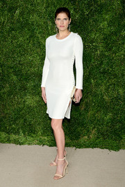 Lake Bell showed off her toned physique in a body-con white sweater dress by Calvin Klein at the CFDA/Vogue Fashion Fund Awards.
