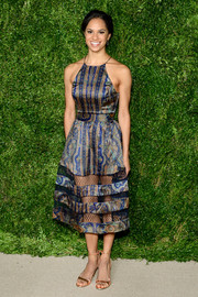Misty Copeland flashed some leg in a Zimmermann print dress with a mesh-panel skirt during the CFDA/Vogue Fashion Fund Awards.