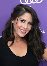 Soleil Moon Frye pulled back her beachy waves into a boho cool half up 'do.