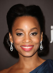 Actress Anika Noni arrived in her one-shouldered navy gown looking radiant. Her voluminous bun gave the starlet some added height and volume. Darling!