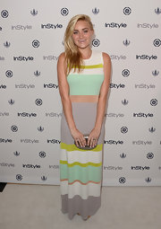 AJ went for soft summer pastels when she wore this varying-stripe maxi.
