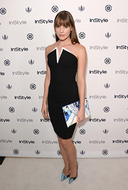 Christa B. Allen looked sleek and modern in fitted black dress with a pointed bustier with a double-layered neckline.