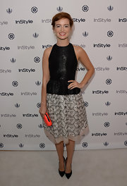 Ahna got playful with her style when she wore this A-line that featured a black peplum top and a floral skirt.