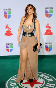 Merche wore a nude evening dress with a suspender style design for the Latin Grammy Awards.