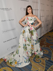 Sofia Carson looked spring-ready in a strapless flower-and-butterfly-print ball gown by Monique Lhuillier at the Los Angeles Ballet Gala.