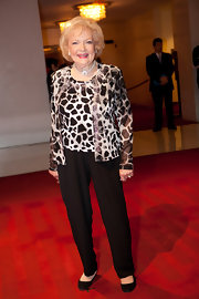 Betty paired her classic black slacks with a zebra print blouse and matching cardigan.