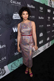 Alexandra Shipp coordinated her dress with a pair of purple sandals.