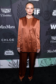 Kate Bosworth kept it simple in a loose rust-colored pantsuit by Max Mara at the Women in Film Oscar nominees party.