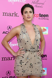 Actress Nikki Reed paired her dangling earrings with a stunning dress by designer Chris Benz.