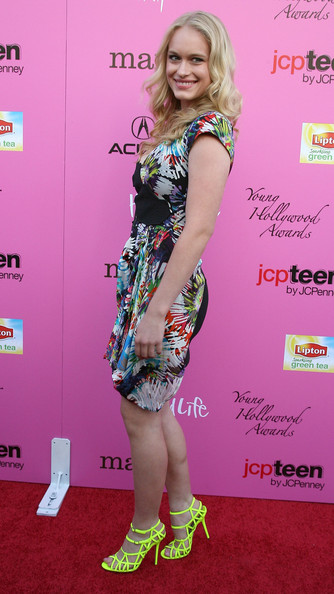 """Lady crossing! Leven walked the red carpet in a highlighter yellow pair of strappy """"Ceasar"""" sandals."""