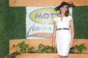 Kate cinched her waist at the Kentucky Derby in a chic navy leather belt.