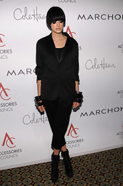 With three chunky bangle bracelets on both wrists, Agyness rocks an all-black outfit.