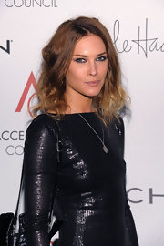 Erin Wasson showed off her two-tone shoulder length curls while attending the Accessories Council.
