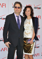 Wendi Deng carried a croc-skin clutch at the 13th Annual AFI Awards.