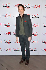 Eddie Redmayne looked cool and sophisticated in a gray suit with green cardigan at the AFI Awards.