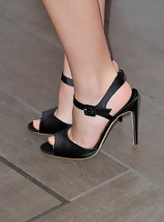 Kiernan Shipka gave herself a boost in black satin sandals.