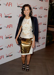 Wendi Deng attended the 13th AFI Awards wearing a white pencil skirt with a metallic gold patch.
